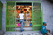 A customer enters Katherine Navas'  family internet and copy shop in Caracas, Venezuela. (Katherine Navas is featured in the book What I Eat: Around the World in 80 Diets.)