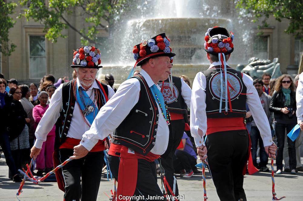 Morris Dancers dancing in Trafalgar Squuare London