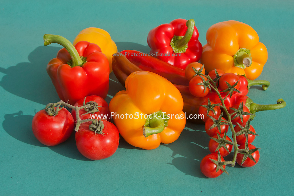 Cherry Tomatoes Chilli and Bell Peppers on green background