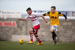 Stirling Albion's Phil Johnston and East Fife's Jamie Insall. <br /> Half time : East Fife 0 v 0 Stirling Albion, Scottish Football League Division Two game played atBayview Stadium, 20/2/2106.
