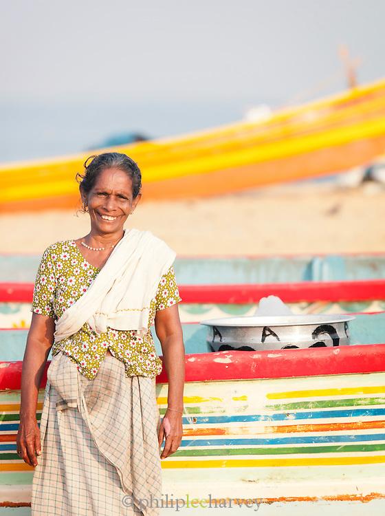 A fish seller at the market on Poovar Beach, near Trivandrum (Thiruvananthapuram), Kerala, India