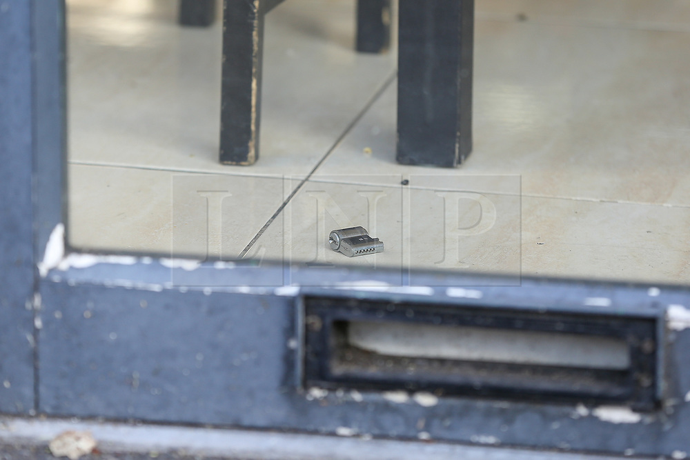 © Licensed to London News Pictures. 18/09/2019. London, UK. A broken lock inside Sweet Peppa - a Jamaican Cuisine on Lordship Lane near Wood Green underground station in North London following a shooting at 9.50pm on Tuesday, 17 September. A short time later, a 46-year-old woman and a 31-year-old man presented themselves at hospital. The woman had sustained a gunshot injury and her condition has been assessed as critical. The condition of the 31-year-old man is not life-threatening or life-changing. He is thought to have sustained a minor gunshot injury. Photo credit: Dinendra Haria/LNP
