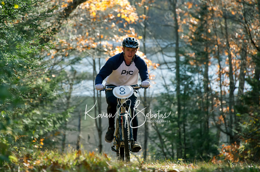 grinds up the Rock Loop trail during Gunstock's Fall Flurry mountain bike race Saturday morning.  (Karen Bobotas/for the Laconia Daily Sun)