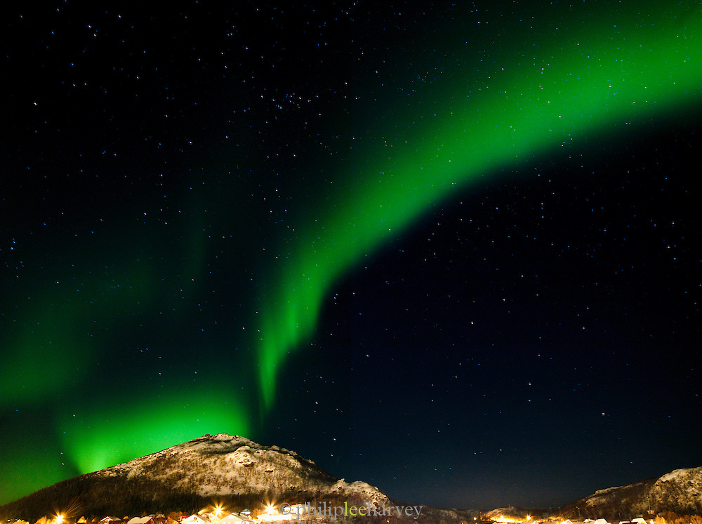 The Aurora Borealis, the Northern Lights, over the landscapes of northern Norway