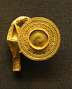 Pair of gold earrings 800-750 BC. Both sides of the disks are decorated with fine granulation arranged in wave and zigzag patterns. The centres of the disks and the other settings would originally have been inlaid probably with amber or rock crystal.