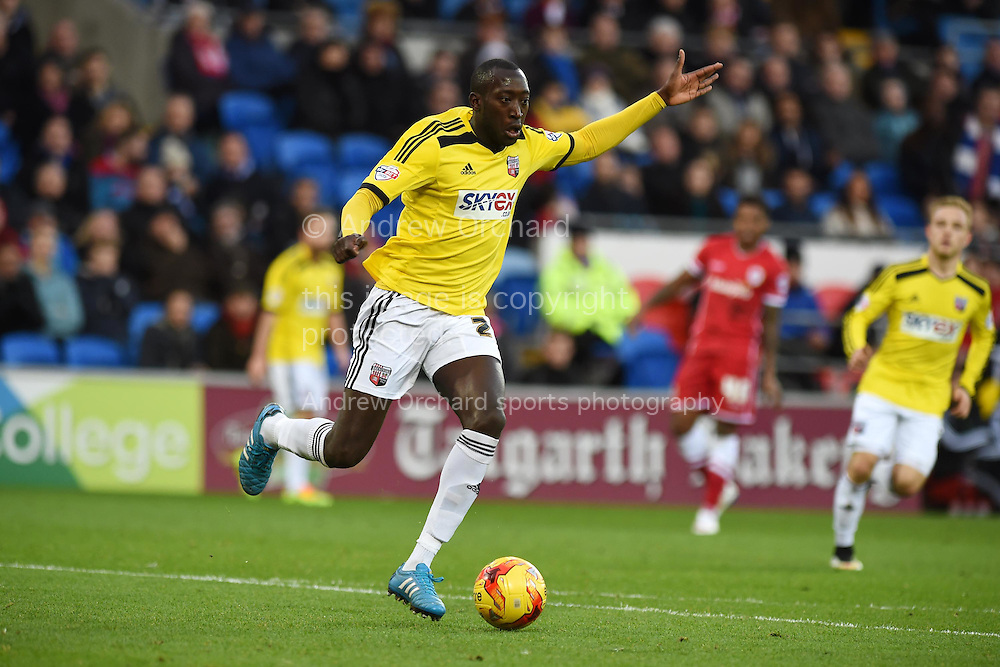 Toumani Diagouraga of Brentford in action. Skybet football league championship match, Cardiff city v Brentford at the Cardiff city stadium in Cardiff, South Wales on Saturday 20th December 2014<br /> pic by Andrew Orchard, Andrew Orchard sports photography.
