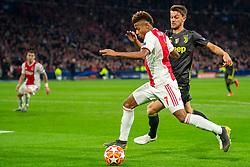 10-04-2019 NED: Champions League AFC Ajax - Juventus,  Amsterdam<br /> Round of 8, 1st leg / Ajax plays the first match 1-1 against Juventus during the UEFA Champions League first leg quarter-final football match / David Neres #7 of Ajax, Daniele Rugani #24 of Juventus