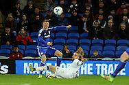 Cardiff City's Anthony Pilkington (blue) crosses while being challenged by Leeds United's Guiseppe Bellusci. Skybet football league championship match, Cardiff city v Leeds Utd at the Cardiff city stadium in Cardiff, South Wales on Tuesday 8th March 2016.<br /> pic by Carl Robertson, Andrew Orchard sports photography.