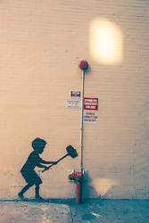 one of graffiti artist Banksy's works on a wall in New york City