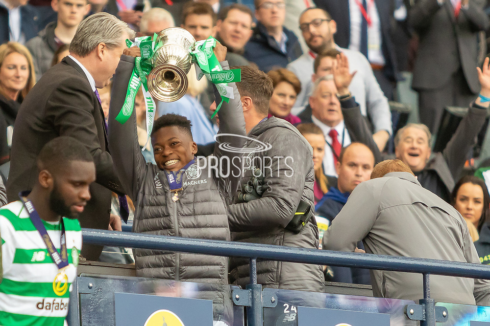 Karamoko Dembele gets his 1st taste of the Scottish Cup success and holds the William Hill Scottish Cup aloft following their victory today in the William Hill Scottish Cup Final match between Heart of Midlothian and Celtic at Hampden Park, Glasgow, United Kingdom on 25 May 2019.
