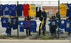 Volunteers hang up shirt tributes, left for the victims of the Helicopter crash, which have been re-located to a new memorial site nearer to the crash site at the King Power Stadium, Leicester.