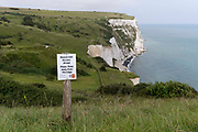 A hilltop landscape of Englands iconic White Cliffs, under threat from chalk and soil erosion, on 27th July, at Langdon Bay, Dover, in Kent, England.