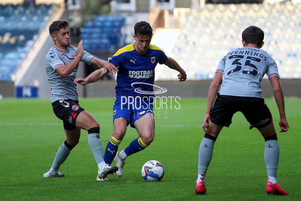 AFC Wimbledon midfielder Callum Reilly (33) battles for possession during the EFL Trophy Group O match between AFC Wimbledon and Charlton Athletic at the Kiyan Prince Foundation Stadium, London, England on 1 September 2020.