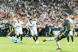 Miralem Pjanic of Juventus FC scores a penalty during the UEFA Champions League group H match between Valencia FC and Juventus FC at Estadi de Mestalla on September 19, 2018 in Valencia, Spain