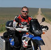 James Pratt portrait on a 2002 BMW F650GS Dakar in western Oklahoma