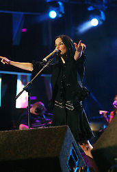 Andrea Corr performs on stage..50,000 people filed into Murrayfield Stadium in Edinburgh, Scotland, on Wednesday July 6, 2005. The free gig, labelled Edinburgh 50,000 - The Final Push was the last of Bob Geldof's momentous Live 8 concerts..Pic ©2010 Michael Schofield. All Rights Reserved.