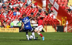 Conor Gallagher of Charlton Athletic and David Davis of Birmingham City go in for a tackle - Mandatory by-line: Arron Gent/JMP - 14/09/2019 - FOOTBALL - The Valley - Charlton, London, England - Charlton Athletic v Birmingham City - Sky Bet Championship