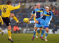 Photo: Alan Crowhurst.<br />Wycombe Wanderers v Rochdale. Coca Cola League 2.<br />10/12/2005. <br />Sergio Torres (R) of Wycombe challenges Tommy Jaszczun.