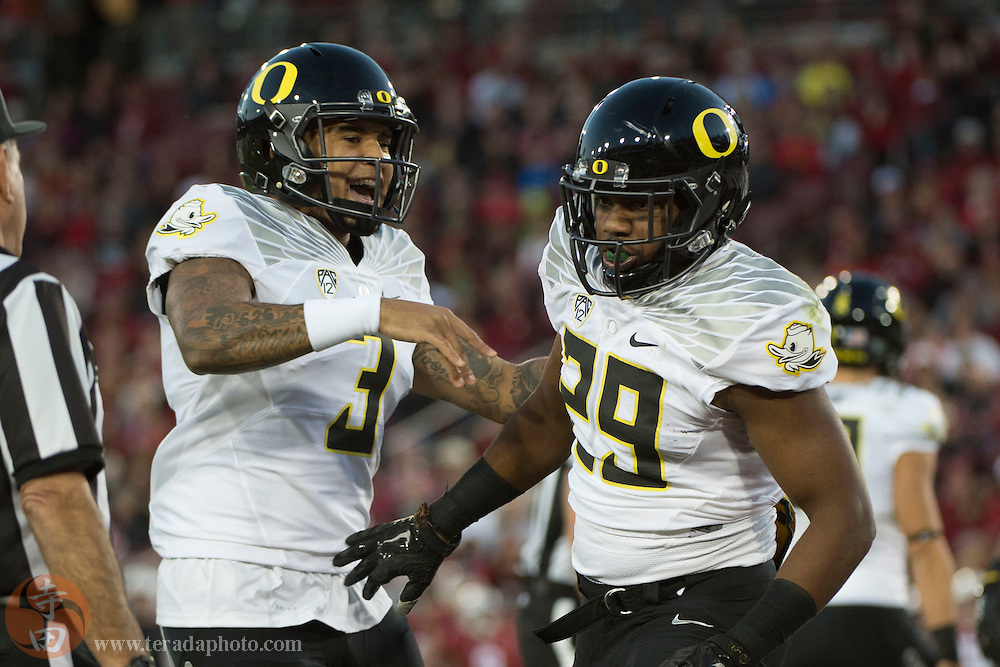 November 14, 2015; Stanford, CA, USA; Oregon Ducks running back Kani Benoit (29) is congratulated by quarterback Vernon Adams Jr. (3) for scoring a touchdown against the Stanford Cardinal during the first quarter at Stanford Stadium.
