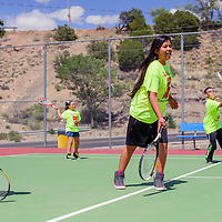 061814       Cable Hoover<br /> <br /> Caitlin James and other novice tennis players do practice exercises during the Gallup Bengals tennis camp at Ford Canyon Park in Gallup Wednesday.