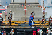 Jesus is crucified and is nailed to the cross - The Wintershall Players open-air re-enactment of 'The Passion of Jesus' on Good Friday in the rain in Trafalgar Square. It featured a cast of over 100 volunteers from in and around London.