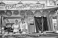 Black and white photo of women working in a food tent during a festival in the town of Cesky Krumlov in the Czech Republic