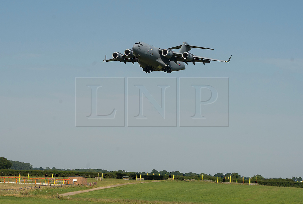 © Licensed to London News Pictures. 01/07/2015. Brize Norton, UK. An RAF C17 transport aircraft arrives at RAF Brize Norton Airport in Oxfordshire carrying the bodies of 8 British people killed in the Tunisia gun attack as they are repatriated to the UK. 38 people were killed when gunman Seifeddine Rezgui opened fire on holiday makers at the resort of Sousse in Tunisia. Photo credit: Ben Cawthra/LNP