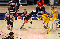 Jan 25, 2021; Morgantown, West Virginia, USA; Texas Tech Red Raiders guard Kevin McCullar (15) dribbles the ball up the floor during the first half against the West Virginia Mountaineers at WVU Coliseum. Mandatory Credit: Ben Queen-USA TODAY Sports
