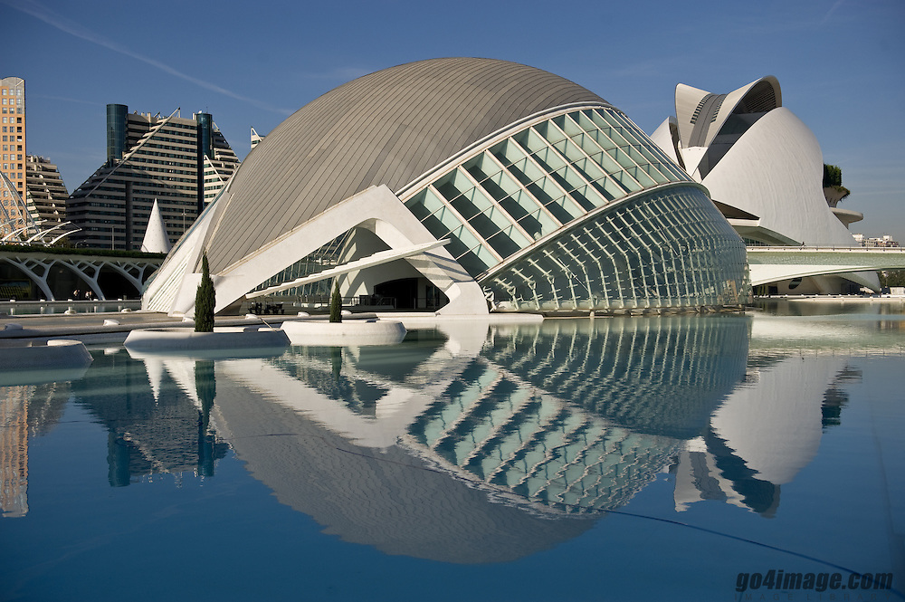 """Museum of Science, Spain, Valencia<br /> The City of Arts and Sciences (Valencian: Ciutat de les Arts i les Ciències; Spanish: Ciudad de las Artes y las Ciencias) is an entertainment-based cultural and architectural complex in the city of Valencia, Spain. It is the most important modern tourist destination in the city of Valencia.<br /> <br /> The City of Arts and Sciences is situated at the end of the former riverbed of the river Turia, which was drained and rerouted after a catastrophic flood in 1957. The old riverbed was turned into a picturesque sunken park.<br /> <br /> Designed by Santiago Calatrava and Félix Candela, the project underwent the first stages of construction in July 1996 and the finished """"city"""" was inaugurated April 16, 1998 with the opening of L'Hemisfèric. The last great component of the City of Arts and Sciences, El Palau de les Arts Reina Sofia, was presented on October 9, 2005, Valencian Community Day."""