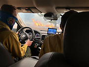 Flame flank the road as Larimer County Sheriff's Office firefighters in a type 6 engine respond to protect a private inholding structure in Moraine Park, Rocky Mountain National Park during the East Troublesome Fire, October 24, 2020. © 2020 William A. Cotton