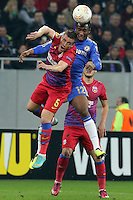 Chelsea's John Obi Mikel (R) vies with Steaua Bucharest's Mihai Doru Pintilii (L) during the first leg of the UEFA Europa League round of 16 football match between Steaua Bucharest and Chelsea at the National Arena Stadium in Bucharest on March 7, 2013.