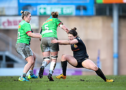 Lauren Cattell of Exeter Chiefs attempts a tackle on Fi Fletcher of Harlequins - Mandatory by-line: Andy Watts/JMP - 06/02/2021 - Sandy Park - Exeter, England - Exeter Chiefs Women v Harlequins Women - Allianz Premier 15s