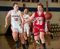 Belmont's Elizabeth Yelle and Laconia's MJ Bordeau drive down court during the Holiday Basketball Tournament at Gilford High School Friday evening.  (Karen Bobotas/for the Laconia Daily Sun)