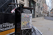 As the UK government tells the nation to prepare for the worst two weeks of the Coronavirus pandemic, a warning aimed at the population to stay at home and minimise contact with others, but in the week when new vaccination centres are opening, is an old Evening Standard newspaper headline with more bad news about NHS hospitals being unable to cope due to Covid, on 11th January 2021, in the City of London, England.