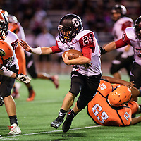 Stephen Miller carries the ball for the Grants Pirates against the Gallup Bengals at Angelo Dipaolo Memorial Stadium in Gallup, Friday, August 31, 2018.
