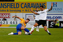 Calum Butcher of Mansfield Town slides in to tackle George Thorne of Derby County - Mandatory by-line: Ryan Crockett/JMP - 18/07/2018 - FOOTBALL - One Call Stadium - Mansfield, England - Mansfield Town v Derby County - Pre-season friendly