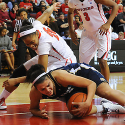 Notre Dame Fighting Irish guard Kayla McBride (23) protects a recovered loose ball from Rutgers Scarlet Knights guard Briyona Canty (25) during second half NCAA Big East women's basketball action between Notre Dame and Rutgers at the Louis Brown Athletic Center. Notre Dame defeated Rutgers 71-41.