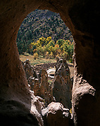 Natural arch framing Tyuonyi Ruin dating from A.D. 1383 to 1466, Frijoles Canyon, Bandelier National Monument, New Mexico.