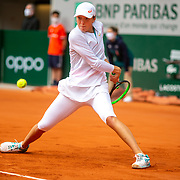 PARIS, FRANCE October 08.  Iga Swiatek of Poland in action against Nadia Podoroska of Argentina in the Semi Finals of the singles competition on Court Philippe-Chatrier during the French Open Tennis Tournament at Roland Garros on October 8th 2020 in Paris, France. (Photo by Tim Clayton/Corbis via Getty Images)