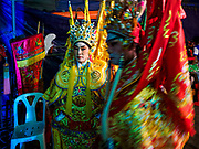 """26 FEBRUARY 2018 - BANGKOK, THAILAND: Performers backstage during a Chinese Opera at the Phek Leng Shrine in the Khlong Toey section of Bangkok. The shrine traditionally hosts a Chinese Opera just after the end of Lunar New Year festivities. Thailand is home to the largest population of overseas Chinese in the world, and Chinese cultural practices, like Chinese opera, called """"ngiew"""" in Thailand, are popular. Many of the performers are ethnic Thais who don't speak Chinese. They learn their lines phonetically.     PHOTO BY JACK KURTZ"""