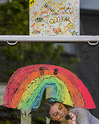 A young girl draws her rainbow message of hope and thanks, to key workers, on the front window of her house in Balham - The 'lockdown' continues for the Coronavirus (Covid 19) outbreak in London.