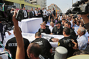 """Florin Cioaba's coffin arrives at the hearse outside the king's palace. The route from Florin Cioba's home to the cemetery - there are crowds of people. Many people, onlookers Gypsy and not line the streets, watching from windows and the pavement. The hearse is surrounded by security.<br /><br />Florin Ciaoba's funeral and the crowning of two kings. Daniel and Dorian were crowned, Danile with the bigger crown is King of Romanian Roma Gypies whilst his older Brother Dorian has the smaller crown and is King of Gypsies of the world and deals with foriegn affairs. His hearse (a lorry) packed with security guards is taken from The Cioaba family home to the cemetery<br /><br />Florin Tănase Cioabă (1954 – 18 August 2013) was a Romanian Romani Pentecostal minister and self-proclaimed """"King of Roma around the world"""". He died on 18 August 2013 of cardiac arrest at Akdeniz Üniversitesi in Antalya. He was 58 years old.<br /><br />In September 2003, Florin Cioaba sparked controversy when he married his 12 year-old daughter Ana-Maria to Mihai Bitrita, a Roma boy aged 15. However, following the wave of criticism, he promised to work to uproot the tradition of child marriages among the Roma. Florin Cioaba also encouraged Roma families to send their children to school during his attempt to fight poverty resulting from a lack of education.<br /><br />Cioaba was elected president of the International Romani Union in April this year"""