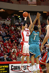 18 November 2007: Levi Dyer shots the three over Montez Downey. Illinois State Redbirds defeated the Seahawks of the University of North Carolina - Wilmington 89-73 on Doug Collins Court in Redbird Arena on the campus of Illinois State University in Normal Illinois.