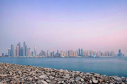 Skyline of skyscrapers at dusk in Dubai United Arab Emirates