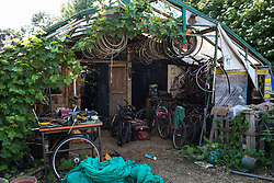Sipson, UK. 5th June, 2018. A bicycle repair space is pictured at Grow Heathrow. Grow Heathrow is a squatted off-grid eco-community garden founded in 2010 on a previously derelict site close to Heathrow airport to rally support against government plans for a third runway and it has since made a significant educational and spiritual contribution to life in the Heathrow villages, which remain threatened by Heathrow airport expansion.