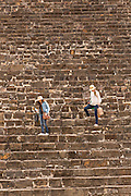 Tourists walks down the steps of the south platform of Monte Albán pre-Columbian archaeological site in the Santa Cruz Xoxocotlán, Oaxaca, Mexico.