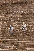 Tourists walks down the steps of the south platform of Monte Albán pre-Columbian archaeological site in the Santa Cruz Xoxocotlán, Oaxaca, Mexico.