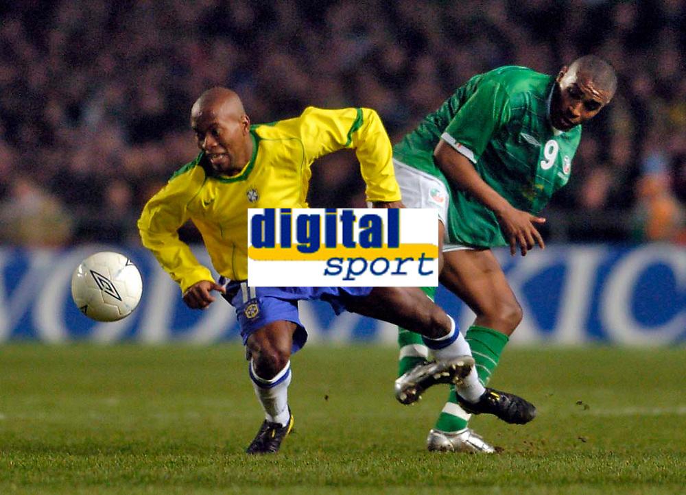 Photo. Jed Wee.<br /> Republic of Ireland v Brazil, International Friendly, Lansdowne Road, Dublin. 18/02/2004.<br /> Ireland's Clinton Morrison (R) sticks out a foot to trip Brazil's Ze Roberto.