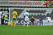 Kuban's Djibril Cisse scores a late equaliser from a penalty to make it 1-1.  UEFA Europa league match, Swansea city v FC Kuban Krasnodar at the Liberty Stadium in Swansea, South Wales on Thursday 24th October 2013. pic by Andrew Orchard, Andrew Orchard sports photography,