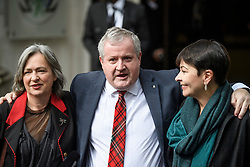 © Licensed to London News Pictures. 24/09/2019. London, UK. LIZ SAVILLE ROBERTS, Westminster leader of Plaid Cymru,  IAN BLACKFORD, Westminster leader of the SNP and CAROLINE LUCAS of the Green Party, are seen celebrating as they leave The Supreme Court in London following a ruling on an appeal against a judicial review of Boris Johnson's suspension of Parliament. The case has been brought by remain campaigner Gina Miller, with support from former British Prime Minister John Major. Photo credit: Ben Cawthra/LNP